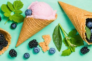 Berry ice cream on rustic wood background