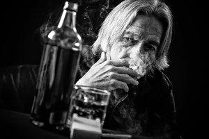 Senior Man Drinking Hard