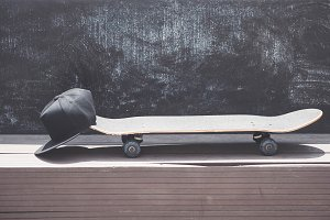 Close-up view of the skateboard with a cap