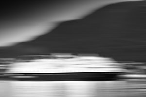 Black and white motion blur moving ship background
