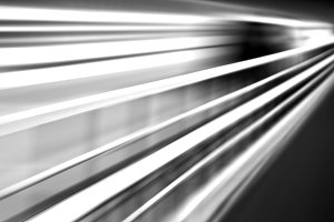 Diagonal black and white motion blur transport background