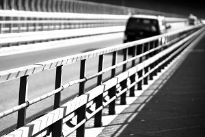 Black and white car on Norway bridge perspective background