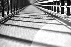 Black and white transport Norway bridge with light leak background