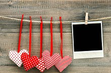 Red hearts and vintage photo frame