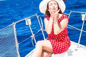 Female on sailboat.