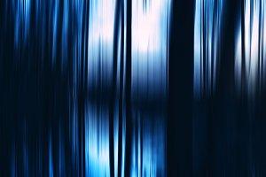 Vertical vivid dark blue curtains motion blur backdrop
