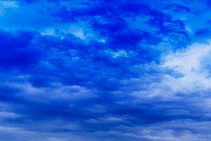 Horizontal wide panorama blue vivid cloudscape background backdr