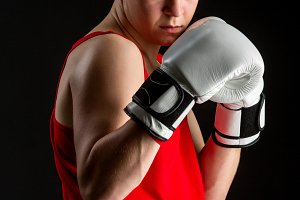 Young boxer sportsman in red sport suit