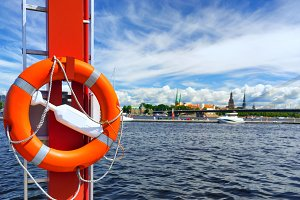 Life ring in the background of the city of Riga