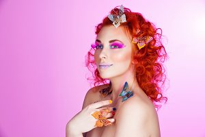 Red hair girl with butterflies