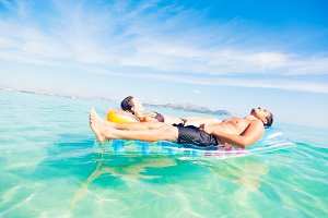 Young Couple With Pool Raft