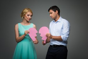 Beautiful couple holding pink broken heart