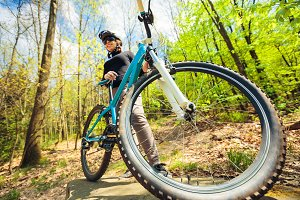 Young Woman Riding Her Mountain Bike