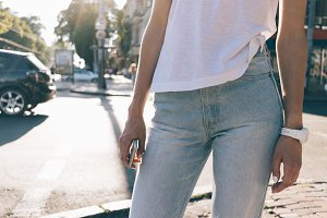 slim woman in jeans and a T-shirt