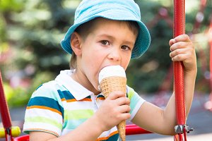 Boy in the park eating ice cream