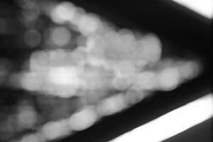 Diagonal black and white bokeh background