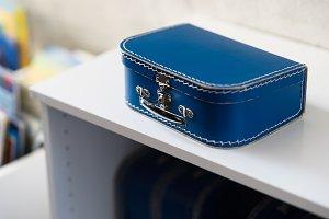 Blue toy case bokeh backdrop