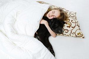 Teen girl sleeping with dog
