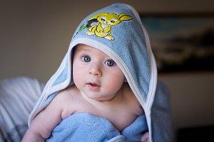 Beautiful baby under vintage towel