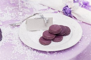 Purple macarons on plate