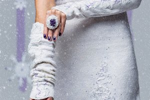 Bride putting mittens on