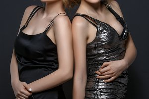 Two beautiful girls in evening dresses