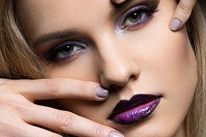 Beautiful girl with dark purple lips