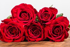 Five red roses