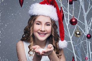 Beautiful girl in christmas cap