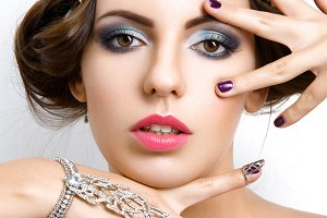 Beautiful girl with make-up and jewelry
