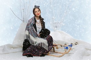 Beautiful Russian girl on sleigh