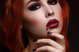 Beautiful vampire young woman
