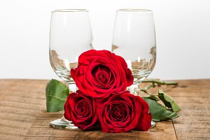 Wine glasses and red roses