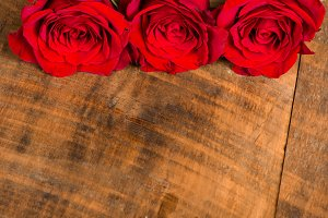 Three red roses room for text