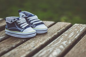 Baby shoes on a bench