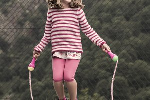 Little girl jumping rope