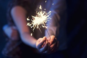 Sparklers in the hands of the coupl