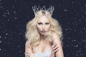 Beautiful woman dressed as winter queen