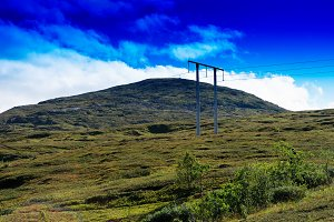Power line in Norway mountain landscape background