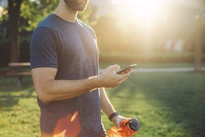 Sporty man using smartphone