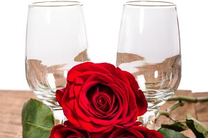 Red roses and wine glasses