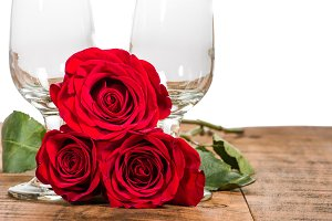Wine glasses with red roses