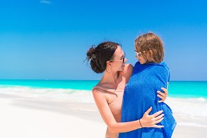 Happy family of mom and kid on the beach vacation