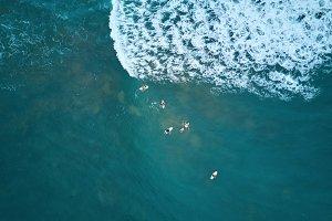 People doing surf in blue ocean