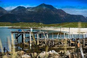 Old broken pier with misc stuff landscape background