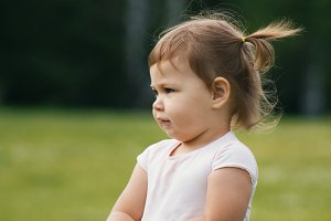 Cute Little toddler girl in park - portrait