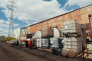 Territory of the plant - plastic containers with spent oil products