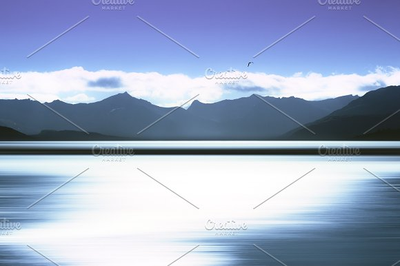 Norway Mountains With Bird And Abstract Ocean Surface Background
