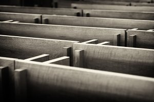 Sepia dark church benches in Norway backdrop