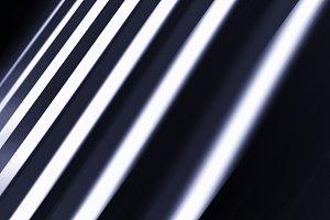 Dark diagonal motion blur panels background